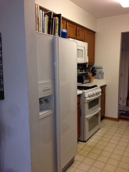 Before Small kitchen with white range and microwave, Northbrook, IL