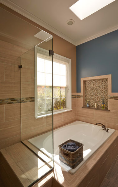 Bathroom Design with tiled tub deck and decorative niche in Riverwoods,
