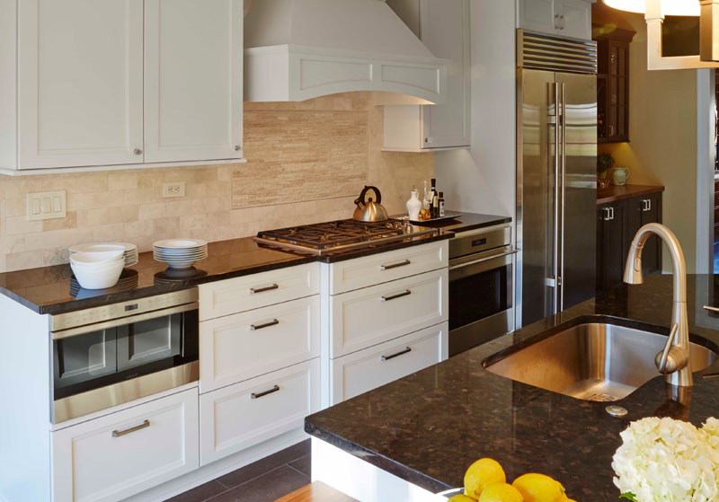 Transitional white painted kitchen design with wood hood in Highland park, IL